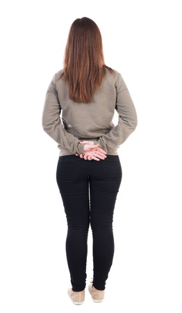 woman behind: back view of standing young beautiful  woman. girl  watching. Rear view people collection.  backside view of person.  Isolated over white background. Girl standing with hands clasped behind his back.