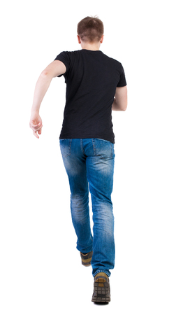 back posing: Back view of running man in brown shirt. Walking guy in motion. Rear view people collection. Backside view of person. Isolated over white background. Man escapes strides. Stock Photo