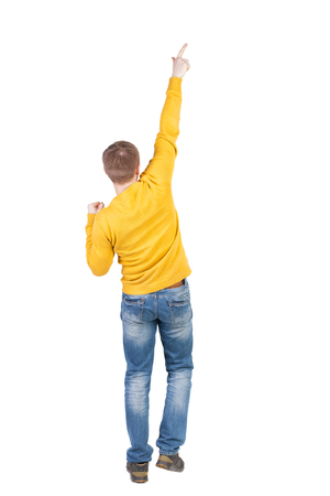 Back view of  man. Raised his fist up in victory sign.   Rear view people collection.  backside view of person.  Isolated over white background. A guy in a jacket dancing. photo
