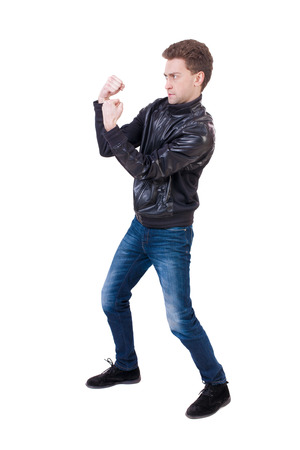 wimp: skinny guy funny fights waving his arms and legs. Isolated over white background. Funny guy clumsily boxing Stock Photo