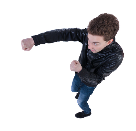fist fight: skinny guy funny fights waving his arms and legs. Isolated over white background. Top view of a fighting man