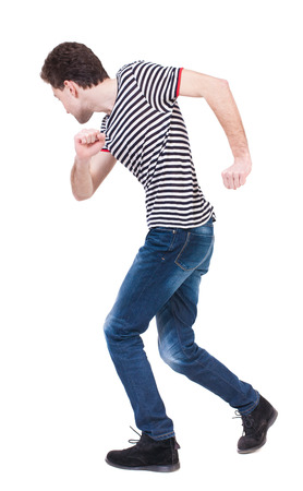 man rear view: Back view of running man in brown shirt. Walking guy in motion. Rear view people collection. Backside view of person. Isolated over white background. The guy in the sailor suit dancing.