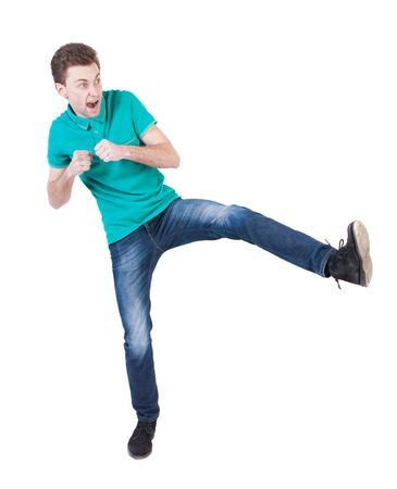 wimp: skinny guy funny fights waving his arms and legs. Isolated over white background. Funny guy clumsily boxing. The guy shouts waving foot Stock Photo