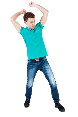 wimp: skinny guy funny fights waving his arms and legs. Isolated over white background. Funny guy clumsily boxing. Angry man with fists brasaetsya to someone else Stock Photo