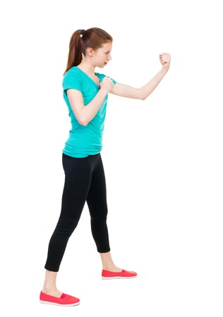 wimp: skinny woman funny fights waving his arms and legs. Isolated over white background. Girl in sportswear in sparring