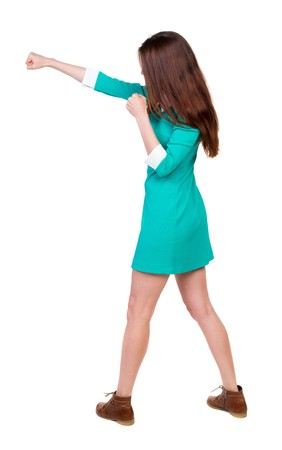 wimp: skinny woman funny fights waving his arms and legs. Rear view people collection.  backside view of person.  Isolated over white background. Girl in aqua dress beats hand.