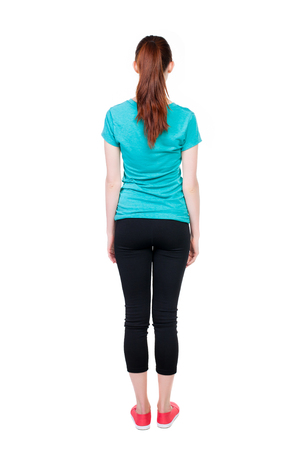 leggings: back view of standing young beautiful  woman. girl  watching. Rear view people collection.  backside view of person.  Isolated over white background. Girl in sports leggings.