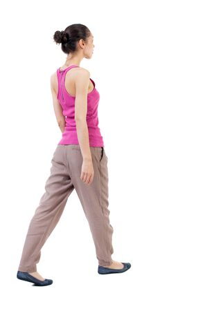 hair tied: back view of walking  woman. beautiful curly girl in motion.  backside view of person.  Rear view people collection. Isolated over white background. woman with hair tied in a bundle of leaves Stock Photo
