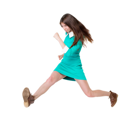 back view of running  woman. beautiful girl in motion. backside view of person.  Rear view people collection. Isolated over white background. purposeful girl in broad jump photo