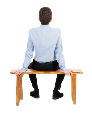 back posing: back view of business man sitting on chair.  businessman watching. Rear view people collection.  backside view of person.  Isolated over white background. Businessman resting on a wooden bench