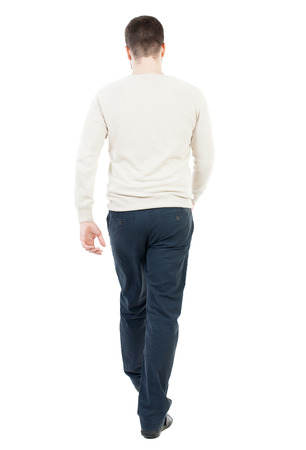 treading: Back view of going  handsome man. walking young guy . Rear view people collection.  backside view of person.  Isolated over white background. The guy in the demi-season jacket leaves. The man in black trousers walks