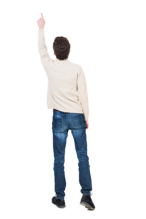 powerfully: Back view of pointing business man. gesticulating young guy in black suit. Rear view people collection.  backside view of person.  Isolated over white background. office worker in a shirt and trousers powerfully indicates something Side. The man saw somet
