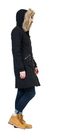 parka: Back view of going  woman in parka.