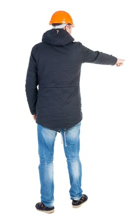 parka: Back view of  pointing young men in parka and helmet.