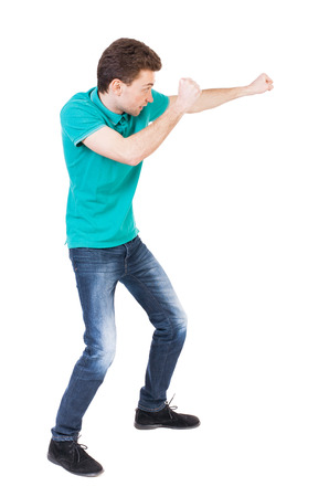 wimp: back view of skinny guy funny fights waving his arms and legs. Stock Photo