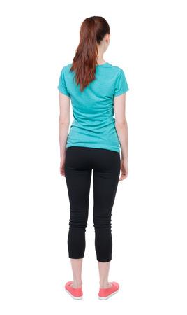 personas de pie: vista trasera de la mujer hermosa joven de pie. Foto de archivo