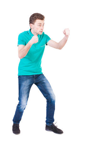 wimp: skinny guy funny fights waving his arms and legs. Isolated over white background. Funny guy clumsily boxing. Enraged man in a boxing pose. Stock Photo