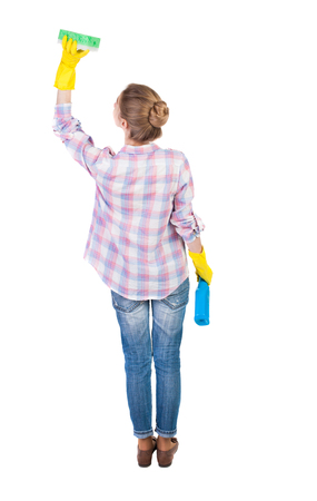 Back view of a housewife in gloves with sponge and detergent. girl  watching. Rear view people collection.  backside view of person.  Isolated over white background. Housewife washes the ceiling. photo