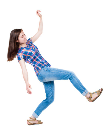 only adult: Balancing young woman.  or dodge falling woman. Rear view people collection.  backside view of person.  Isolated over white background. A young girl in a checkered blue with red stripes makes a great step forward. Stock Photo