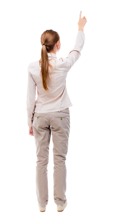 woman in suit: Back view of  pointing woman. beautiful girl. Rear view people collection.  backside view of person.  Isolated over white background. A girl standing in a light suit and jeans showing thumbs up.