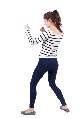 wimp: skinny woman funny fights waving his arms and legs. Isolated over white background. Frenchwoman in vest standing in a boxing pose. Stock Photo