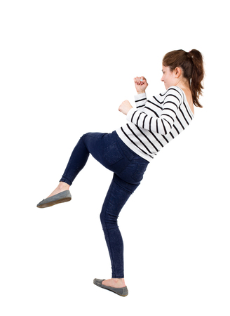 wimp: skinny woman funny fights waving his arms and legs. Isolated over white background. Frenchwoman in vest standing fighters pose.