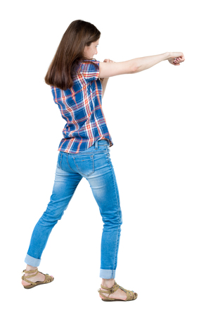 wimp: skinny woman funny fights waving his arms and legs. Isolated over white background. A young girl in a checkered blue with red stripes student punched.
