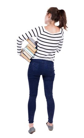 frenchwoman: A girl carries a heavy pile of books. back view. Rear view people collection.  backside view of person.  Isolated over white background. Frenchwoman in vest is holding a stack of books under his arm.