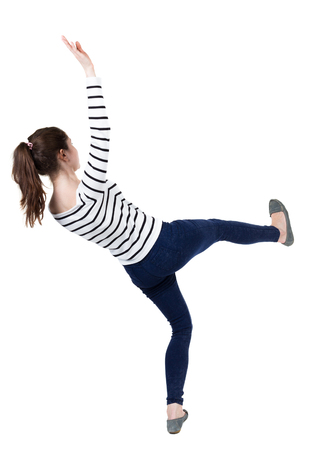 frenchwoman: Balancing young woman.  or dodge falling woman. Rear view people collection.  backside view of person.  Isolated over white background. Frenchwoman in vest falls on his back slipping. Stock Photo