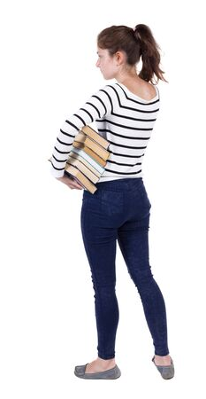 frenchwoman: A girl carries a heavy pile of books. back view. Rear view people collection.  backside view of person.  Isolated over white background. Frenchwoman in vest is holding a stack of books under his arm and looks thoughtfully ahead.