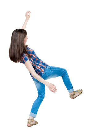 slipped: Back view woman Balances waving his arms.   Standing young girl in jeans. Rear view people collection.  backside view of person.  Isolated over white background. A young girl in a checkered blue with red stripes and slipped trying not to fall. Stock Photo