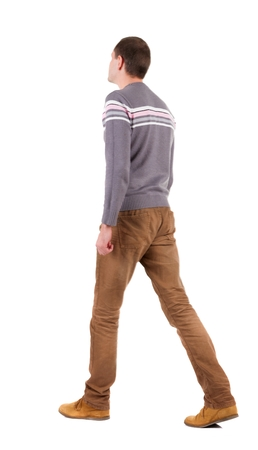treading: Back view of going  handsome man in sweater.  walking young guy in jeans and  jacket. Rear view people collection.  backside view of person.  Isolated over white background.