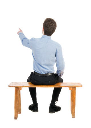 back view of business man sitting on chair and pointing.  businessman watching. Rear view people collection.  backside view of person.  Isolated over white background. Businessman resting on a wooden bench