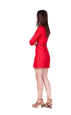 back view of standing young beautiful  woman. Stock Photo