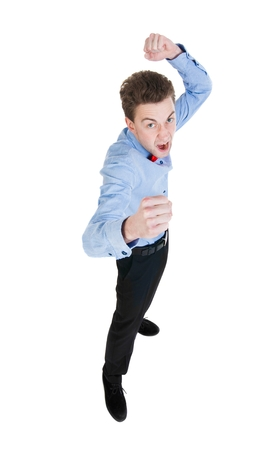 wimp: skinny guy funny fights waving his arms and legs. Isolated over white background. Stock Photo
