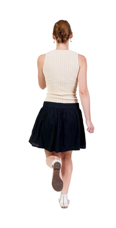 back view of running woman in dress.