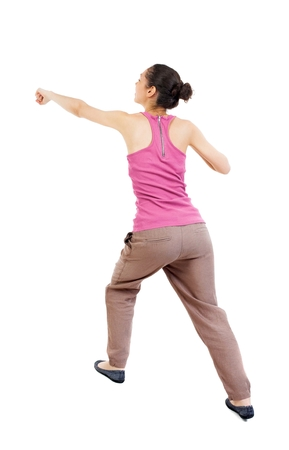 wimp: skinny woman funny fights waving his arms and legs. Rear view people collection.  backside view of person.  Isolated over white background. African-American woman punches