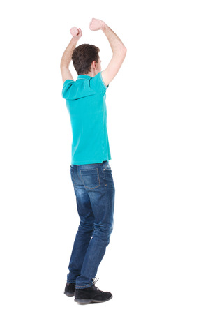 arms above head: Back view of  man.  Raised his fist up in victory sign.   Rear view people collection.  backside view of person.  Isolated over white background. Guy happily he raised both arms above his head. Stock Photo