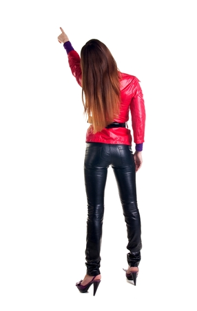 specifies: Young woman points at wall. The rear view. Isolated over white Stock Photo