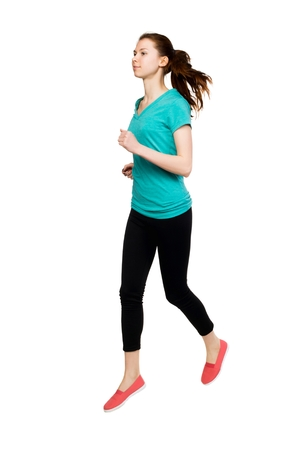 froze: front view of running sport woman. beautiful girl in motion. Sportswoman froze jump. Stock Photo