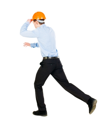 observes: Back view of running engineer in helmet. Walking guy in motion. Rear view people collection. Backside view of person. Isolated over white background. Holding the helmet visor for an engineer to run the event.