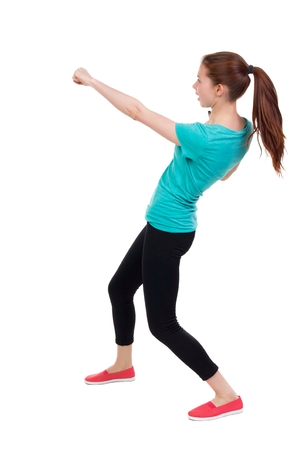 wimp: skinny woman funny fights waving his arms and legs. Rear view people collection.  backside view of person.  Isolated over white background. Girl in sportswear brushes hand.