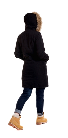 striding: Back view of going  woman in parka. walking young girl. Rear view people collection.  backside view of person.  Isolated over white background.