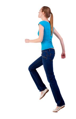 rushes: back view of running  woman  in  jeans. beautiful blonde girl in motion.  backside view of person.  Rear view people collection. Isolated over white background. she rushes to meet someone
