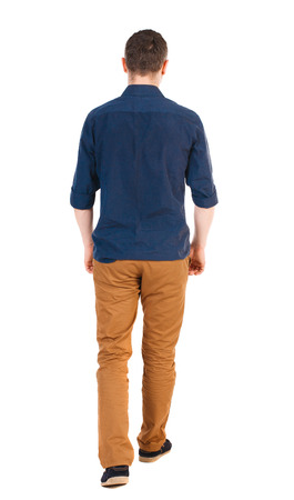 man rear view: Back view of going  handsome man in jeans and a shirt.  walking young guy . Rear view people collection.  backside view of person.  Isolated over white background.  man in brown pants, shirt sleeves rolled away into the distance.