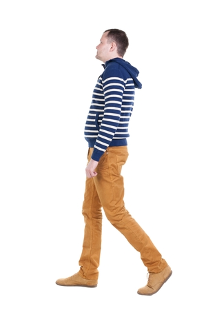 treading: Back view of walking handsome man in jeans and striped sweater.  young guy going . Rear view people collection.  backside view of person.  Isolated over white background. Stock Photo