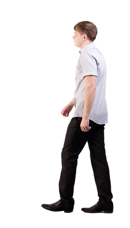 striding: Back view of going  handsome business man in pink shirt  walking young businessman . Rear view people collection.  backside view of person.  Isolated over white background. office worker with a shot from a pants jacket goes away