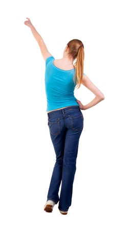 hair tied: Back view of  pointing woman. beautiful blonde  girl in jeans.  Rear view people collection.  backside view of person.  Isolated over white background. long-haired blonde hair tied in a bun shows what is Stock Photo