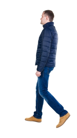 treading: Back view of going  handsome man in jeans and jacket.  walking young guy . Rear view people collection.  backside view of person.  Isolated over white background. Stock Photo