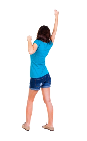 hitchhiking: Back view of  woman thumbs up. Rear view people collection. backside view of person. Isolated over white background. slender brunette in a jeans shows the symbol of success or hitchhiking Stock Photo